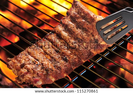 Grilled pork ribs on the grill. - stock photo