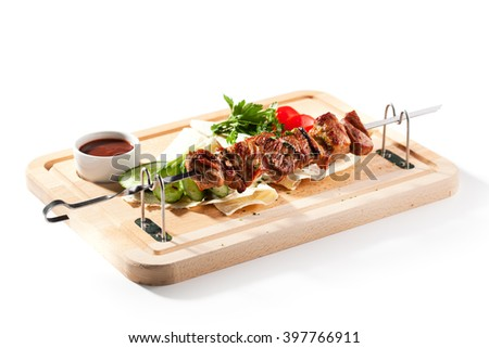 Grilled Pork Skeweres with Vegetables and Sauce - stock photo
