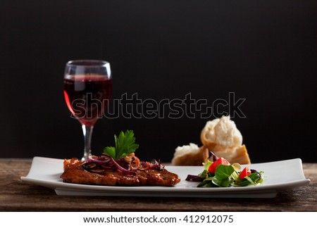 grilled pork steak on a platter  - stock photo