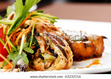 Grilled pork steak with vegetable garnish. - stock photo