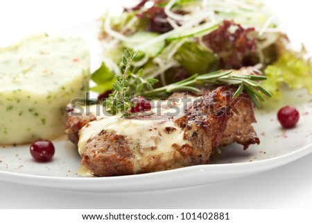 Grilled Pork with Mushed Potato and Raw Vegetables - stock photo