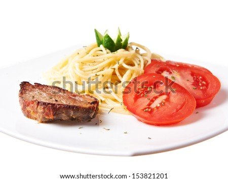 Grilled pork with pasta and tomatoes