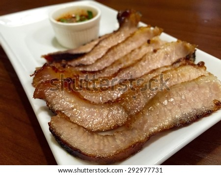 Grilled pork with spicy sauce /Thai food - stock photo