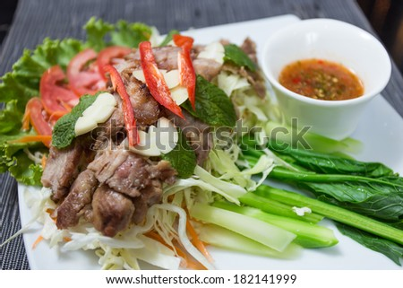 Grilled pork with spicy seafood sauce