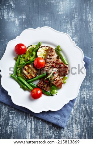Grilled pork with vegetables - stock photo