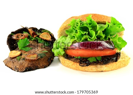Grilled Portobello Mushrooms Caps seasoned (Plain Parsley, Dill, Garlic, Shallot) and Vegetarian burger (Lettuce, Slices Tomato and Red Onion, Grilled Portobello Mushroom over wholegrain bread bun) - stock photo