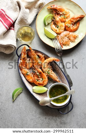 Grilled prawn with garlic salsa sauce on an enamel plate.Top view - stock photo