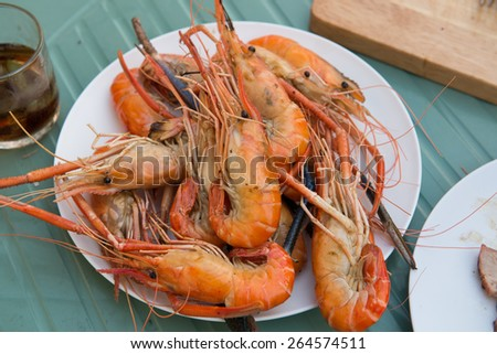 Grilled prawns on plate - stock photo