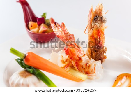 Grilled prawns with asparagus, mushrooms, carrots, and fruits - stock photo
