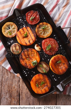 Grilled pumpkin and vegetables on the grill pan closeup. vertical view above, rustic style - stock photo