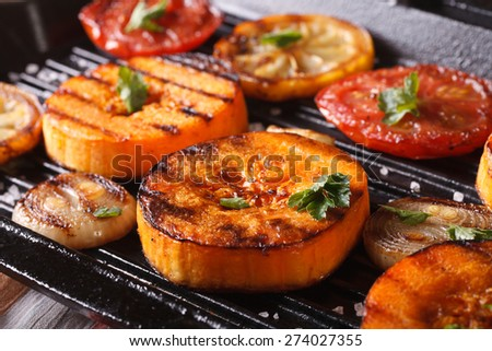 Grilled pumpkin and vegetables on the grill pan. Horizontal macro, rustic style - stock photo