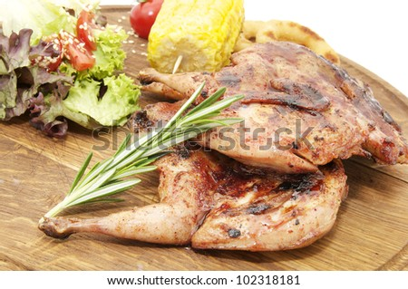 Grilled quail cooking on the grill in the restaurant - stock photo