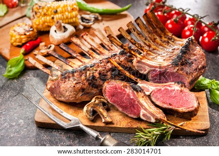 Grilled Rack of lamb on a cutting board - stock photo