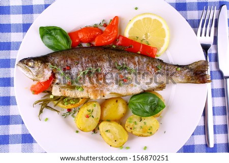 Grilled rainbow trout with red pepper, potato and rosemary, top view - stock photo