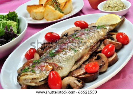grilled rainbow trout with some organic mushroom - stock photo