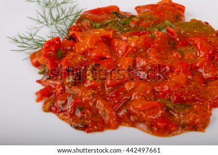 Grilled red bell pepper with tomato sauce - stock photo