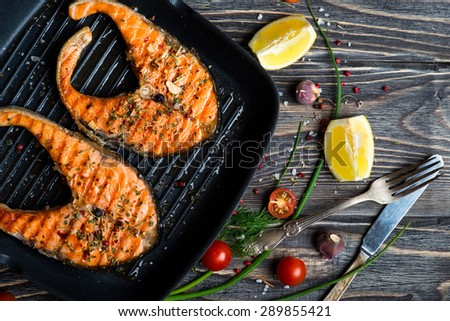Grilled red fish steaks salmon on the grill pan - stock photo