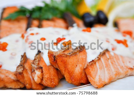 grilled red fish with sauce - stock photo