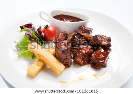 Grilled ribs with barbecue sauce and vegetables