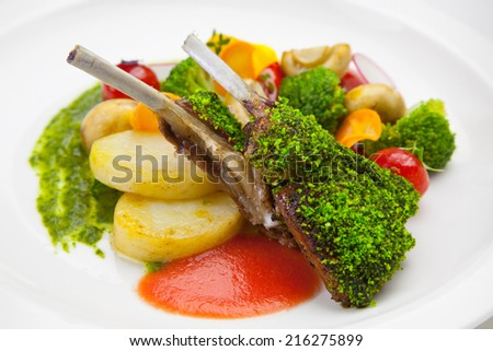 grilled ribs with vegetables on a plate - stock photo