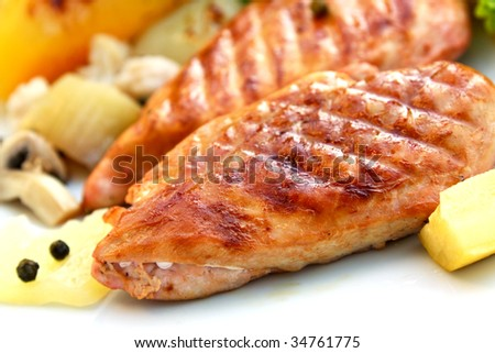 grilled-roasted schnitzel of turkey meat with vegetables - stock photo