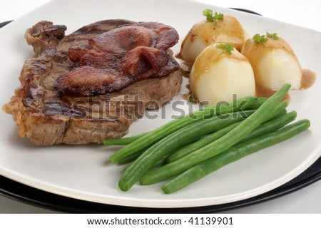 grilled rump steak and bacon with organic vegetable