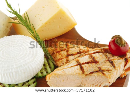 grilled salmon and french cheeses on wooden plate - stock photo