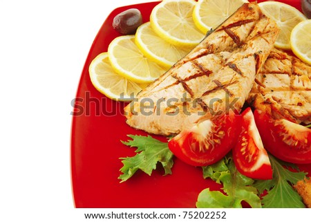 grilled salmon and lemon on red plate - stock photo