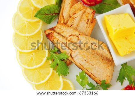 grilled salmon and lemon on white plate