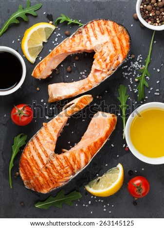 Grilled salmon and spices on stone plate. Top view - stock photo