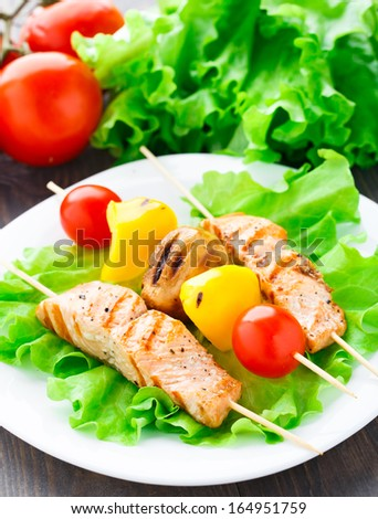 Grilled salmon and vegetable skewers