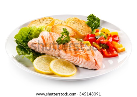Grilled salmon and vegetables on white background  - stock photo
