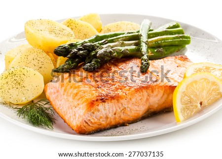 Grilled salmon boiled potatoes and asparagus  - stock photo