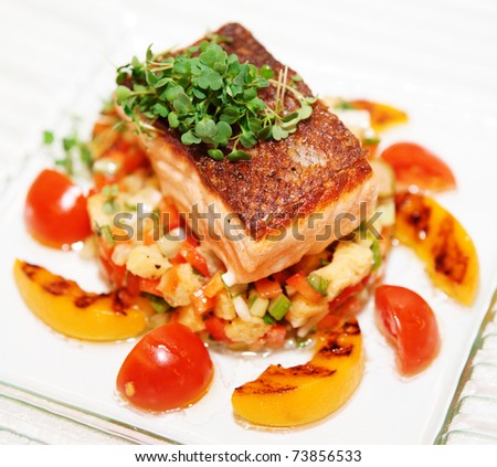 Grilled salmon fillet on glass plate