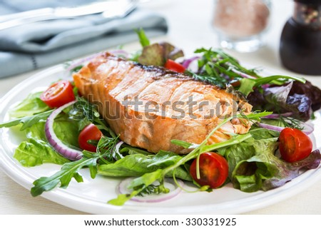Grilled Salmon fillet with fresh salad - stock photo