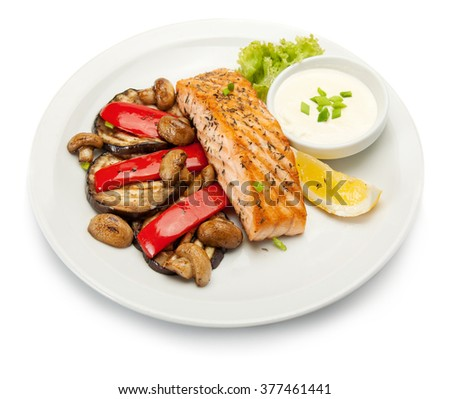 grilled salmon fillet with grilled vegetables. Isolated on white. With clipping path. - stock photo