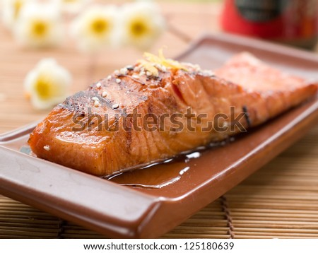 Grilled salmon fillet with sauce and sesame seeds, selective focus - stock photo