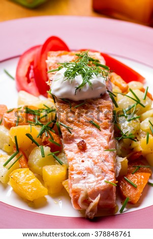 Grilled salmon on a bed of fried potatoes