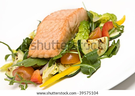 Grilled Salmon on a bed of salad - stock photo