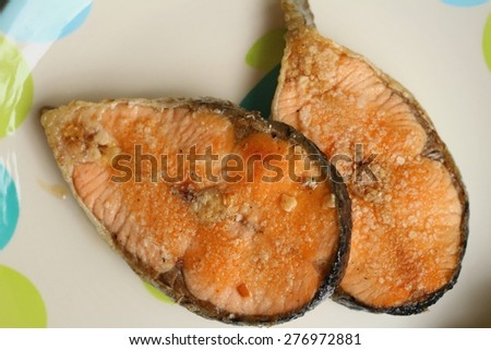Grilled salmon on colorful of a plate