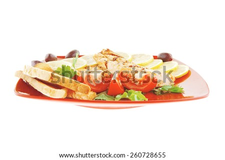 grilled salmon steak on red plate with tomatoes - stock photo