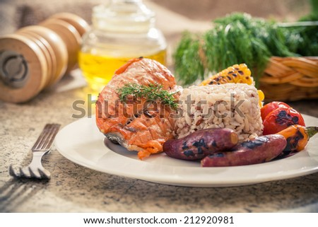Grilled salmon steak with brown rice