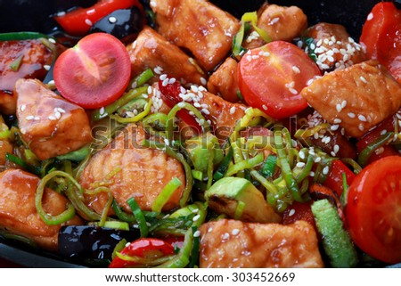 Grilled salmon steak with herbs and vegetables - stock photo