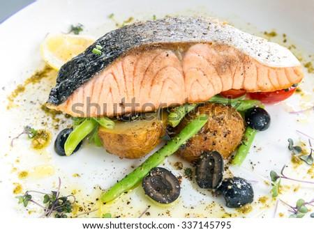grilled salmon steak with pesto sauce - stock photo