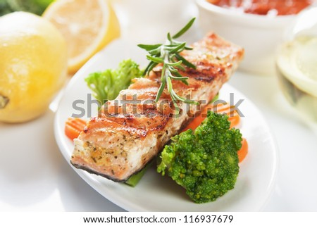 Grilled salmon steak with rosemary and vegetables