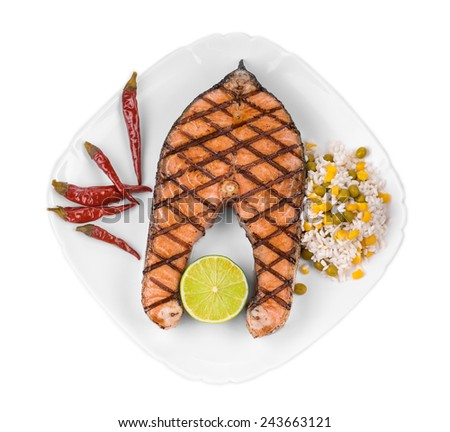 Grilled salmon steak with vegetables on plate. Isolated on a white background. - stock photo