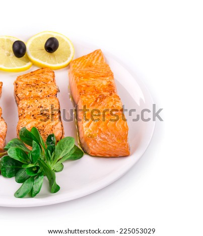 Grilled salmon steak with vegetables on plate. Whole background. - stock photo