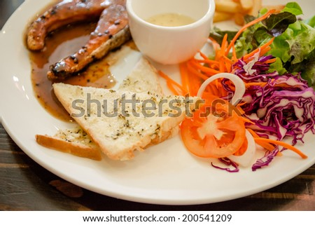 Grilled salmon steak with vegetables salad