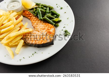 grilled salmon steakk with french fries - stock photo