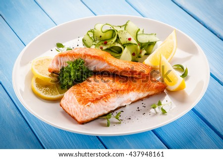 Grilled salmon steaks and vegetables - stock photo